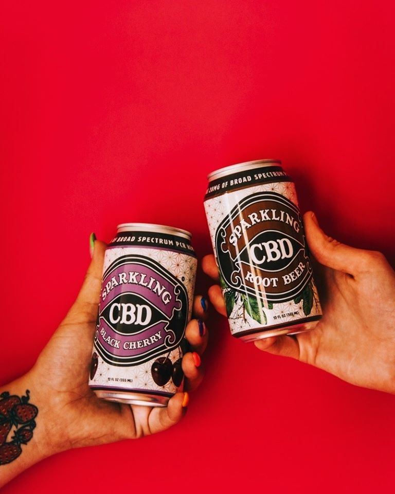 Toasting Cans of Sparkling CBD