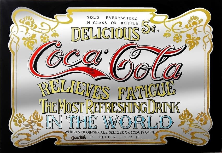 Old-fashioned sign advertises original brand of Coca Cola, sold in the late 1800s for five cents per serving